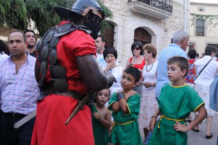 SPAIN. Castilla y Le�n .Burgos .Ba�os de Valdearados .   FEAST of BACCHUS   ; Legionanair talking with children.