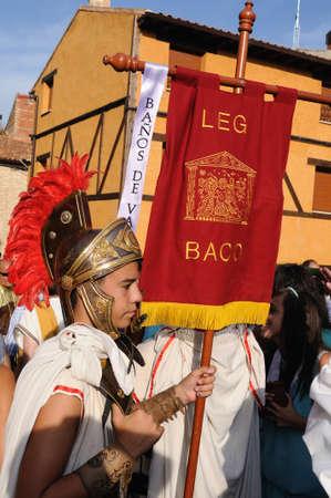 SPAIN. Castilla y Le�n .Burgos .Ba�os de Valdearados .    FEAST of BACCHUS   ;  Legionnaires with  banner  Legion of  Bacchus   in the main square.