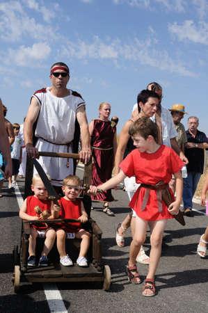 bacchus:  SPAIN. Castilla y Le�n .Burgos .Ba�os de Valdearados .    FEAST of BACCHUS  ; Children playing with swords.