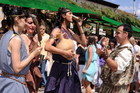 bacchus: SPAIN. Castilla y Le�n .Burgos .Ba�os de Valdearados .    FEAST of BACCHUS   ; Representation  of roman life in the market