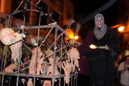 torches:  , Holy Company    Quixote Market  in ALCALA DE HENARES. Spain    Editorial