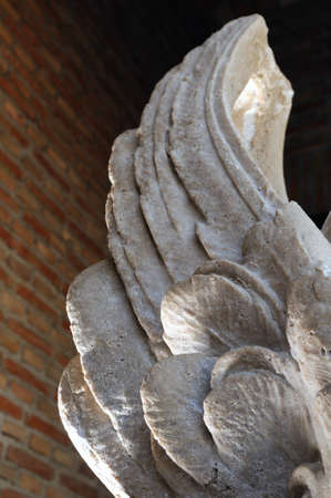 Wings of Chimera . Renaissance (  Plateresque )  ' Weapons Court - ARCHBISHOPS PALACE  '  belonging to the ANTIQUARIUM - Wall of  ALCALA DE HENARES ( 13 th ). Community of Madrid .SPAIN