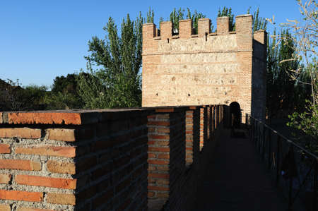 parapet wall: Watchtower  belonging to the Wall of  ALCALA DE HENARES ( 13 th ). Community of Madrid .SPAIN