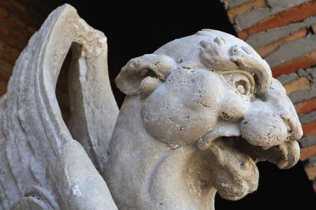 Chimera . Renaissance (  Plateresque )  ' Weapons Court - ARCHBISHOPS PALACE  '  belonging to the ANTIQUARIUM - Wall of  ALCALA DE HENARES ( 13 th ). Community of Madrid .SPAIN