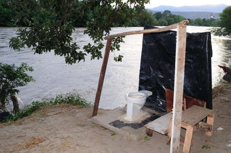 madalena: Toilet  Magdalena River in NEIVA. Department of Huila. COLOMBIA Editorial