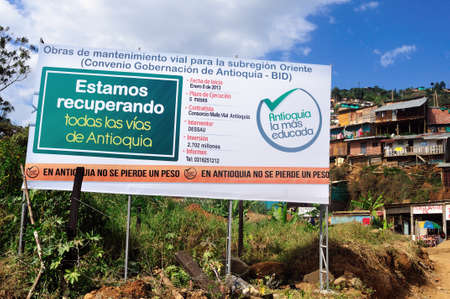 comunas: Sign with information about the Antioquia Government investment in improving road - Santo Domingo district  in MEDELLIN .Department of Antioquia. COLOMBIA Editorial