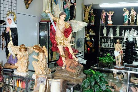 antioquia: San Miguel arcangel - Shop selling religious - Plaza Bolivar in MEDELLIN .Department of Antioquia. COLOMBIA   Editorial