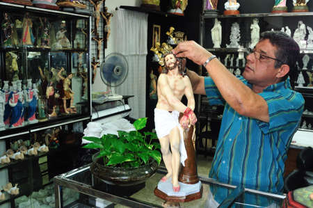 crist:  Shop selling religious - Plaza Bolivar in MEDELLIN .Department of Antioquia. COLOMBIA   Editorial