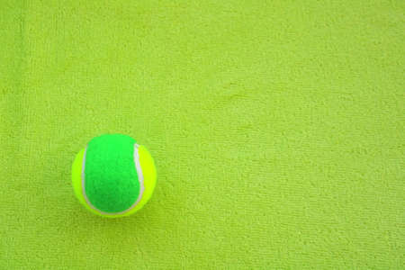 shere: Green Tennis Ball on green
