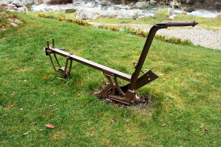 Agricultural manual plow on the grass photo
