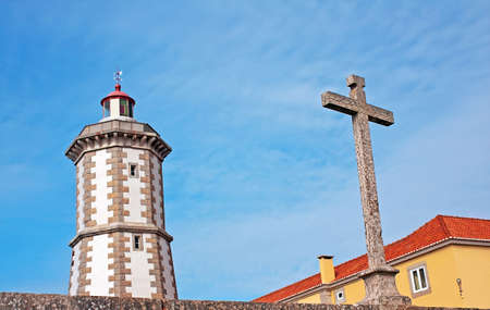 Guia Lighthouse and christian stone cross  photo