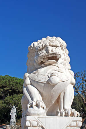 Asian sculpture of a Stone Lion with a Buddha statue photo