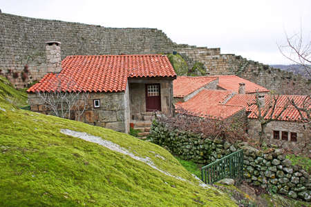 Several medieval houses into the wall castle of Sortelha photo