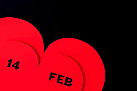 Valentines Day dated in red heart isolated on black Stock Photo - 8627470