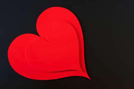Red hearts isolated in a black background Stock Photo - 8775689