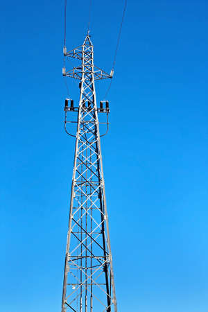 Tower of high voltage electric power with blue sky as background photo