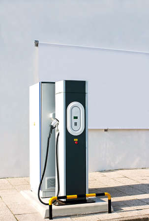 cable car: New charging station for electric car with a white canvas panel for outdoor advertising Stock Photo