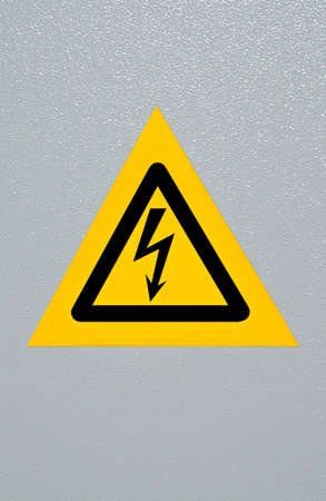 Signal of danger of electrocution from high voltage isolated in grey Stock Photo - 8885490