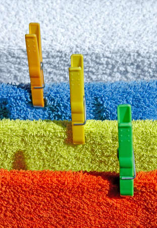 Four cotton colorful towels drying in the sun photo