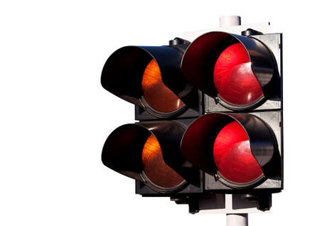 Double of traffic lights, orange and red, to sports car racing isolated on white photo