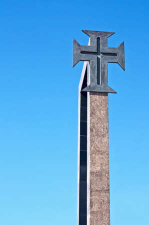 origins: Christian portuguese cross with ancient origins and used in the discoveries, isolated, with the blue sky as background  Stock Photo