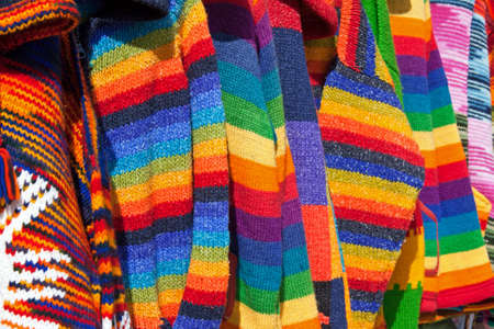 Close up of the texture of several colorful wool clothes photo