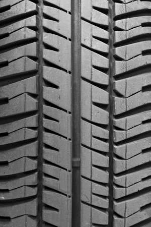 A single tire track in the vertical photo
