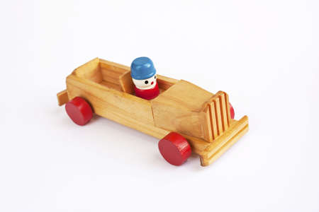 Colorful wooden toy car isolated in white  photo