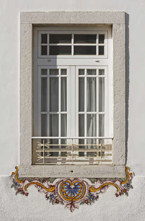 Beautiful window base decorated with colourful tiles photo