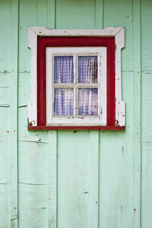 Window of typical wooden huts of the fishermen  photo