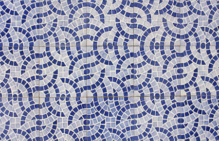 Mosaic of old tiles with abstract design in two shades of blue photo