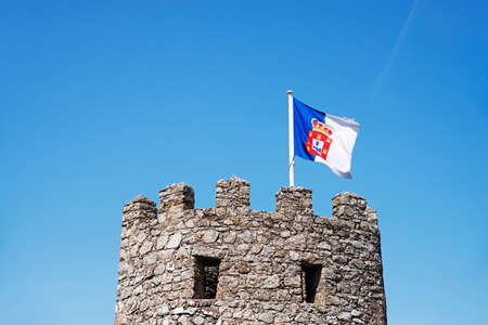 sierra: A tower of west wall of the Moorish Castle, with a Portuguese flag,  in Sintra, Portugal