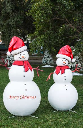 Two spherical snowmen in a park Stock Photo