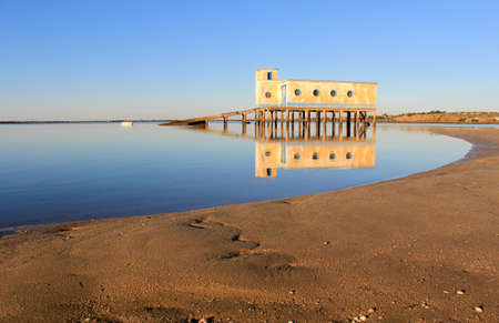 Old historic life-guard bulding in Fuseta, at Ria Formosa conservation park, Algarve. Portugal photo