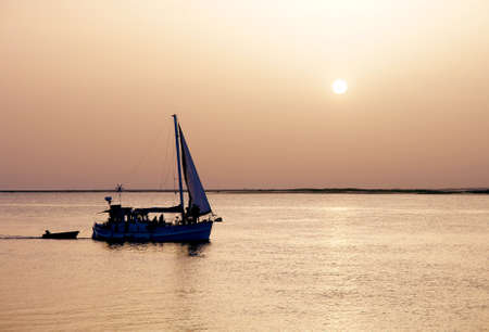 ria: Recreation boat at sunset, in Ria Formosa, natural conservation region in Algarve, Portugal