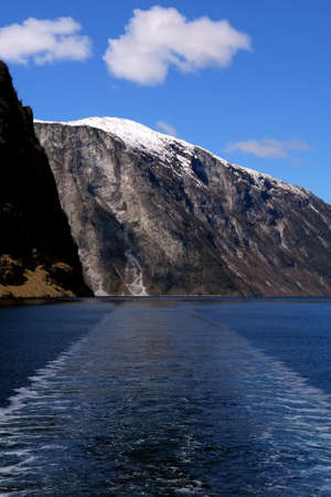 Gudvangen fjord landscape, mountain in the backgroung and boat trail,  Norway Stock Photo - 15611698