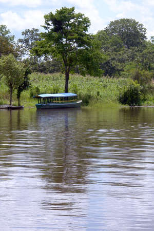 Passenger boat in Amazon river margin, near Leticia, Colombia, Brazil and Peru border triangle area                              photo