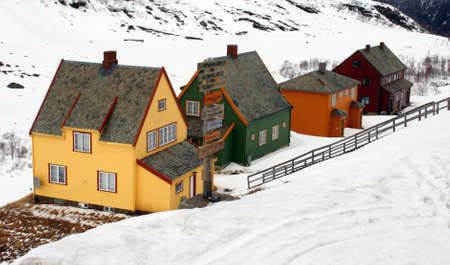 Norway tipical wooden mountain houses, during winter snow season                                Stock Photo - 15625142