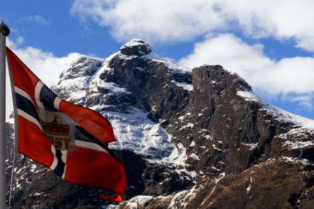 Norway flag in the wind, in mountain landscape, Gudvangen Fjord Stock Photo - 15626367