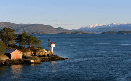 Norway sea island with a small lighthouse Stock Photo - 15626275