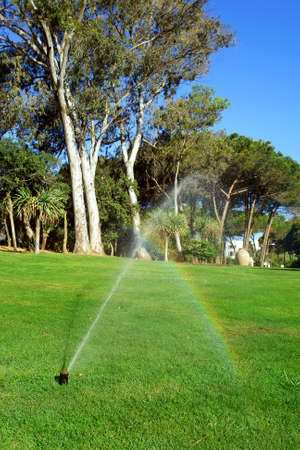 Garden irrigation system and watering rainbow efect                         photo