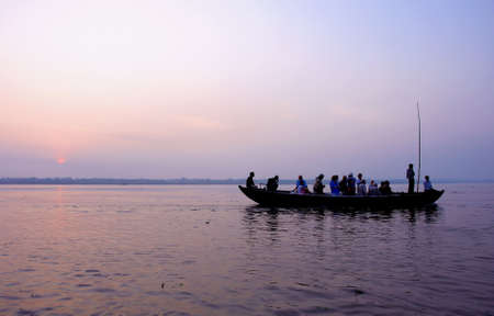 boat trip in ganjes river at sunrise, Varanasi, India photo