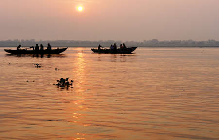 Tradicional boat trip in ganjes river at sunrise, Varanasi, India photo