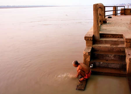 Morning ritual on the Ganges river, Varanasi, India photo