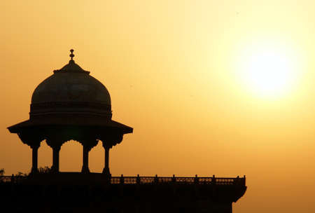 Moslem fortress silhouette at sunrise. Taj Mahal, Agra, India  photo