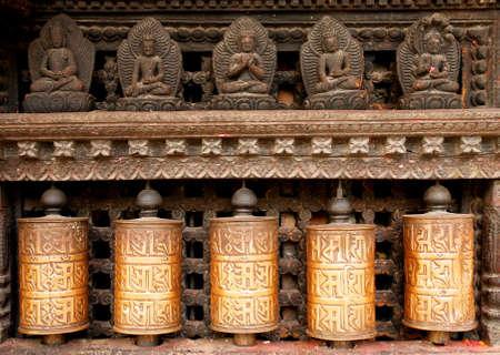 Prayer wheels at swayambhunath monkey temple in Kathmandu, Nepal                               photo