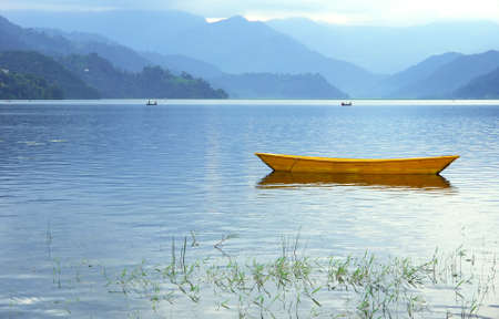 Boats in Pokhara Fewa Lake, Nepal  photo