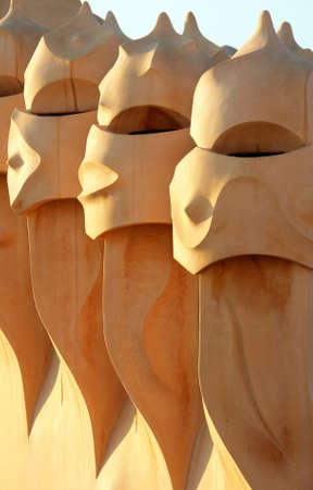 Famous chimneys at Casa Mila (also called La Pedrera) by Antoni Gaudi - roof top - Barcelona                                 Stock Photo