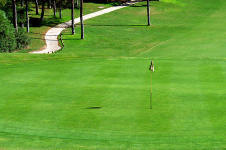Golf course green in Algarve (Portugal) photo