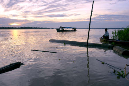 Amazon river landscape   people at sunrise, near Leticia  Colombia-Brazil-Peru border triangle